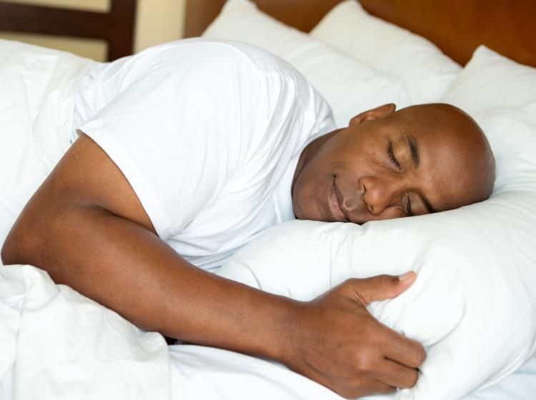 Man sleeps peacefully in bed