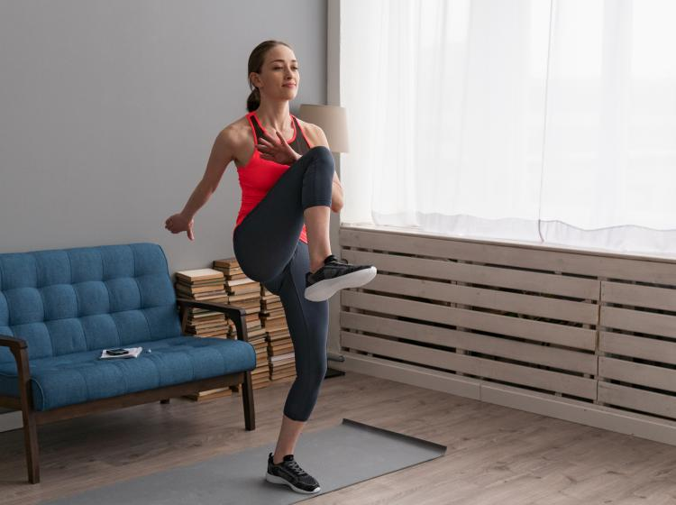 Woman doing high knees exercise at home